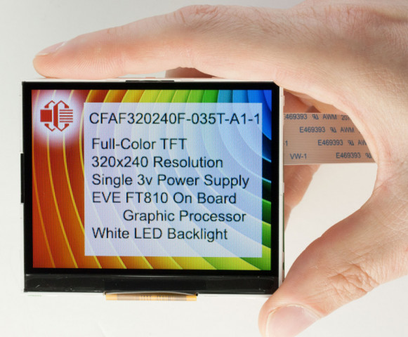 A 3.5 inch diagonal TFT LCD displaying a fact page, held in a person's hand to give size scale. Fact page says: CFAF320240F-035T-A1-1 Full-Color TFT 320x240 Resolution Single 3v Power Supply EVE FT810 On Board Graphic Processor White LED Backlight